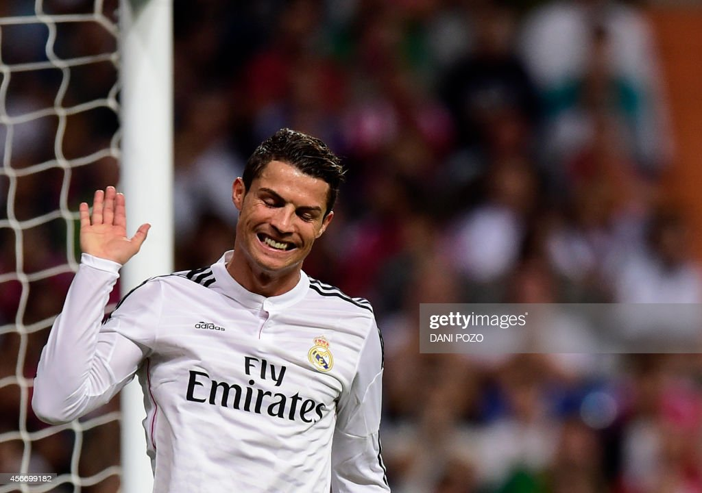 Real Madrid's Portuguese forward Cristiano Ronaldo gestures during the Spanish league football match Real Madrid vs Athletic Club Bilbao at the Santiago Bernabeu stadium in Madrid on October 5, 2014.