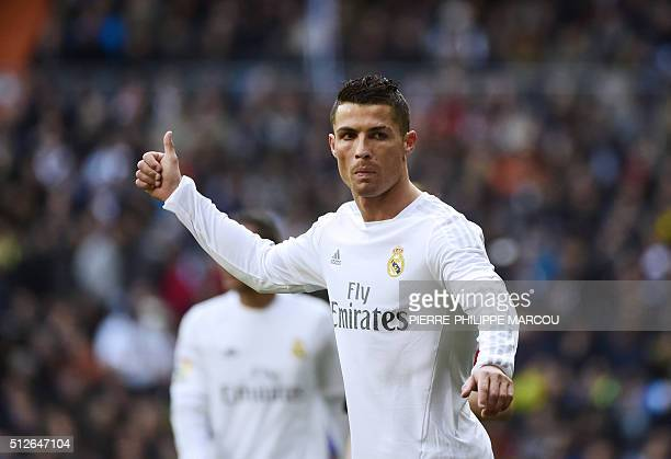 Real Madrid's Portuguese forward Cristiano Ronaldo gestures during the Spanish league football match Real Madrid CF vs Club Atletico de Madrid at the...