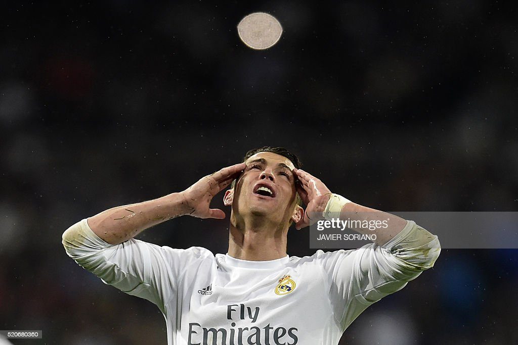 Real Madrid's Portuguese forward Cristiano Ronaldo gestures during the Champions League quarter-final second leg football match Real Madrid vs Wolfsburg at the Santiago Bernabeu stadium in Madrid on April 12, 2016. / AFP / JAVIER
