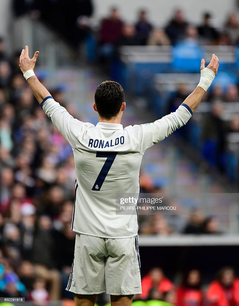 Real Madrid's Portuguese forward Cristiano Ronaldo gestures during the Spanish league football match Real Madrid CF vs Malaga CF at the Santiago Bernabeu stadium in Madrid on January 21, 2017. / AFP / PIERRE