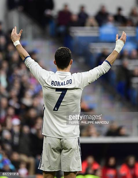 Real Madrid's Portuguese forward Cristiano Ronaldo gestures during the Spanish league football match Real Madrid CF vs Malaga CF at the Santiago...