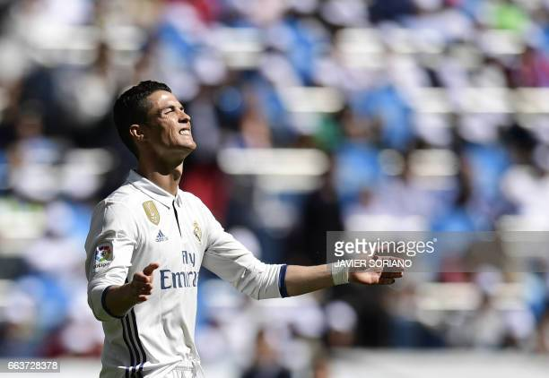 Real Madrid's Portuguese forward Cristiano Ronaldo gestures during the Spanish league football match Real Madrid CF vs Deportivo Alaves at the...