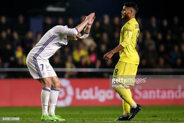 TOPSHOT Real Madrid's Portuguese forward Cristiano Ronaldo gestures in front of Villarreal's Mexican forward Jonathan dos Santos during the Spanish...