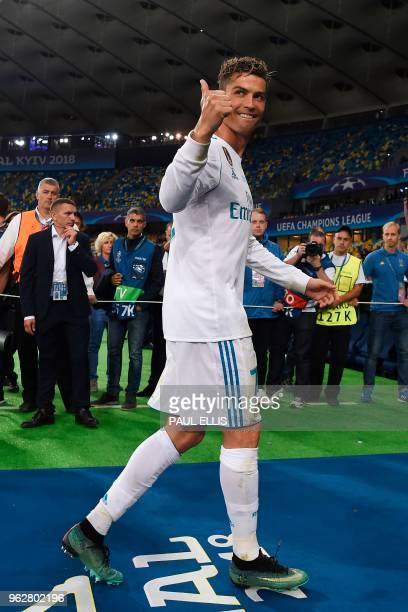 Real Madrid's Portuguese forward Cristiano Ronaldo gestures to supporters after the UEFA Champions League final football match between Liverpool and...