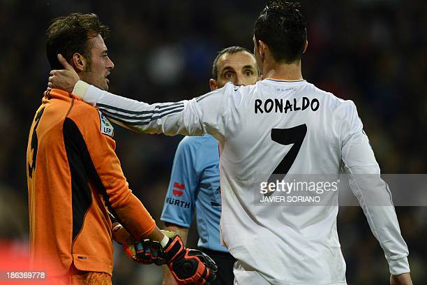 Real Madrid's Portuguese forward Cristiano Ronaldo gestures to Sevilla's Portuguese goalkeeper Beto during the Spanish league football match Real...