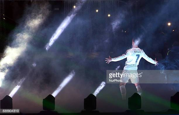 Real Madrid's Portuguese forward Cristiano Ronaldo gestures to supporters during celebrations for their 11th UEFA Champions Cup at the Santiago...