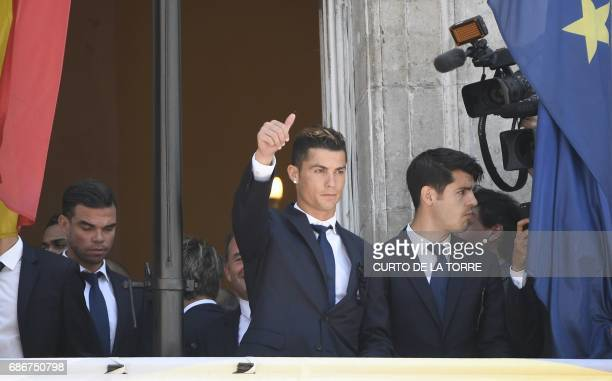 Real Madrid's Portuguese forward Cristiano Ronaldo greets supporters at the Madrid Community headquarters in Madrid on May 22 2017 during a...