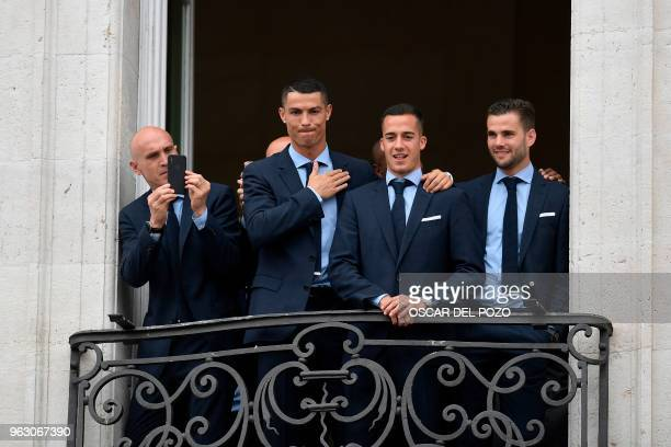 Real Madrid's Portuguese forward Cristiano Ronaldo greets supporters next to Real Madrid's Spanish midfielder Lucas Vazquez and Real Madrid's Spanish...
