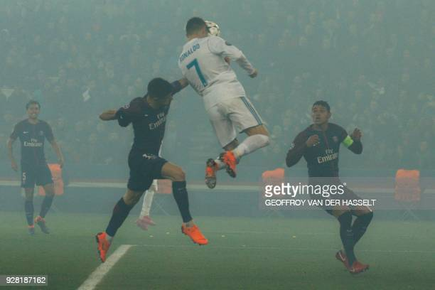 Real Madrid's Portuguese forward Cristiano Ronaldo heads the ball and scores the opening goal during the UEFA Champions League round of 16 second leg...