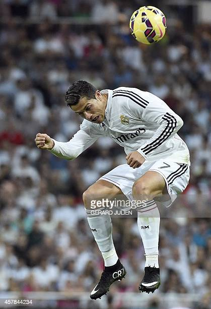 Real Madrid's Portuguese forward Cristiano Ronaldo heads the ball during the Spanish league 'Clasico' football match Real Madrid CF vs FC Barcelona...
