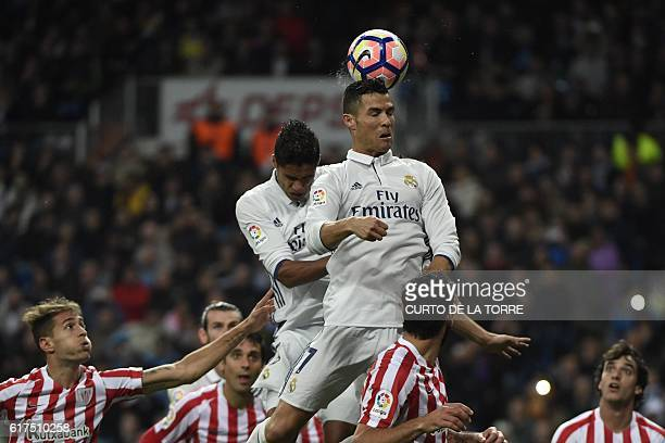 Real Madrid's Portuguese forward Cristiano Ronaldo heads the ball during the Spanish league football match between Real Madrid CF and Athletic Club...