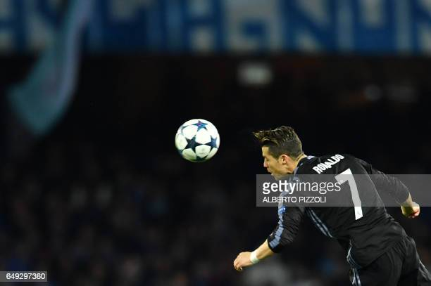 Real Madrid's Portuguese forward Cristiano Ronaldo heads the ball during the UEFA Champions League football match SSC Napoli vs Real Madrid on March...