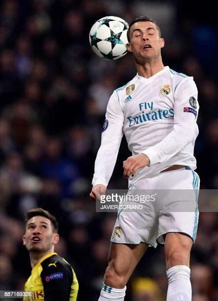 Real Madrid's Portuguese forward Cristiano Ronaldo heads the ball during the UEFA Champions League group H football match Real Madrid CF vs Borussia...