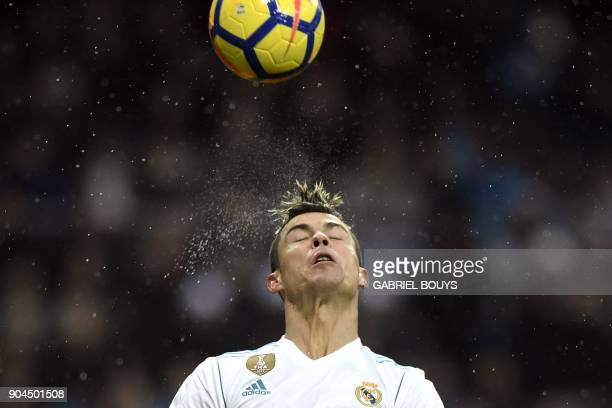 Real Madrid's Portuguese forward Cristiano Ronaldo heads the ball during the Spanish league football match between Real Madrid and Villarreal at the...