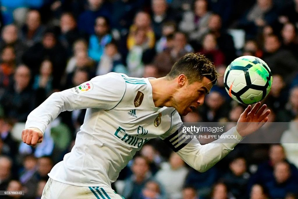 Real Madrid's Portuguese forward Cristiano Ronaldo heads the ball during the Spanish league football match between Real Madrid CF and Deportivo Alaves at the Santiago Bernabeu stadium in Madrid on February 24, 2018. /