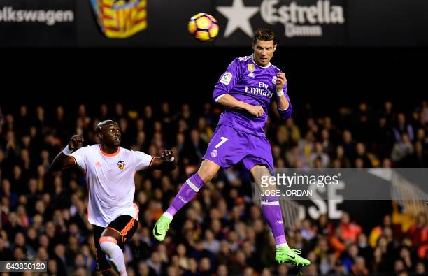 Real Madrid's Portuguese forward Cristiano Ronaldo heads the ball to score a goal during the Spanish league football match Valencia CF vs Real Madrid...