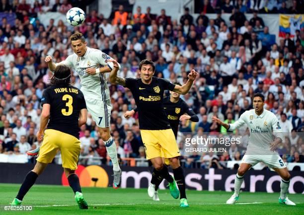 Real Madrid's Portuguese forward Cristiano Ronaldo heads to score during the UEFA Champions League semifinal first leg football match Real Madrid CF...