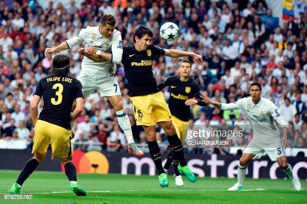 TOPSHOT Real Madrid's Portuguese forward Cristiano Ronaldo heads to score during the UEFA Champions League semifinal first leg football match Real...