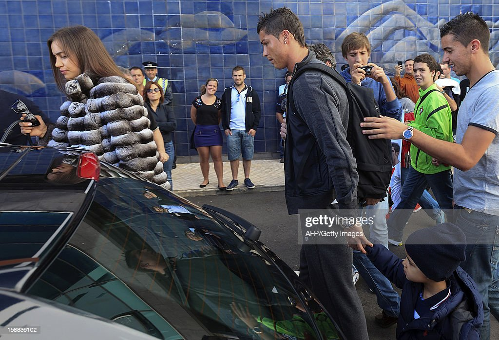 Real Madrid's Portuguese forward Cristiano Ronaldo (2ndR), his son (BottomR) and his girlfriend Irina Shayk (L) arrive at Madeira airport in Funchal on December 31, 2012.