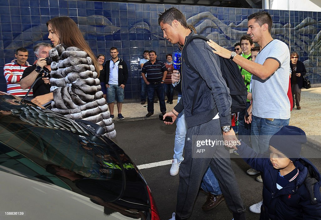Real Madrid's Portuguese forward Cristiano Ronaldo (2ndR), his son Cristiano Jr (BottomR) and his girlfriend Irina Shayk (L) arrive at Madeira airport in Funchal on December 31, 2012.