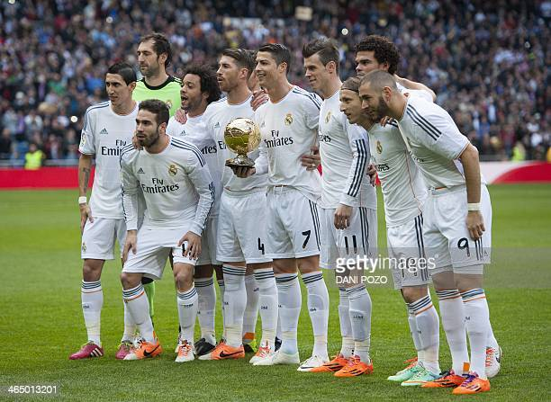 Real Madrid's Portuguese forward Cristiano Ronaldo holds his Ballon d'or trophy as he poses with his teammates Real Madrid's Argentinian midfielder...