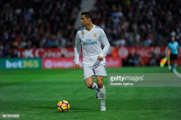 Real Madrid's Portuguese forward Cristiano Ronaldo in action during the Spanish La Liga football match Girona FC vs Real Madrid CF at the Municipal...