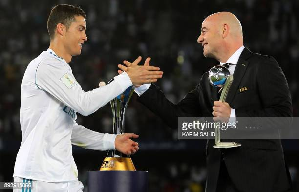 Real Madrid's Portuguese forward Cristiano Ronaldo is awarded the 2017 FIFA Club World Cup Silver Ball by by FIFA president Gianni Infantino after...