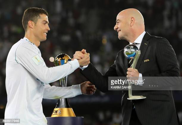 TOPSHOT Real Madrid's Portuguese forward Cristiano Ronaldo is awarded the 2017 FIFA Club World Cup Silver Ball by by FIFA president Gianni Infantino...
