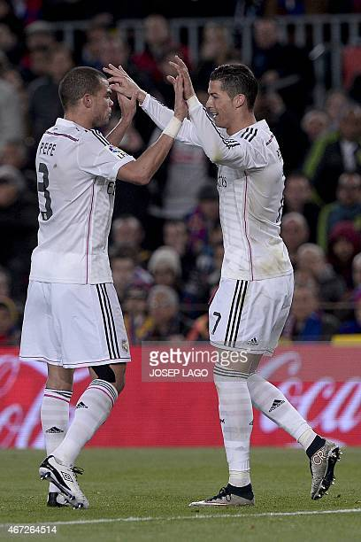 Real Madrid's Portuguese forward Cristiano Ronaldo is congratulated by his teammate Real Madrid's Portuguese defender Pepe after scoring during the...