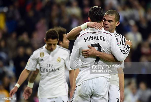 Real Madrid's Portuguese forward Cristiano Ronaldo is congratulated by Real Madrid's Portuguese defender Pepe during the Spanish league football...