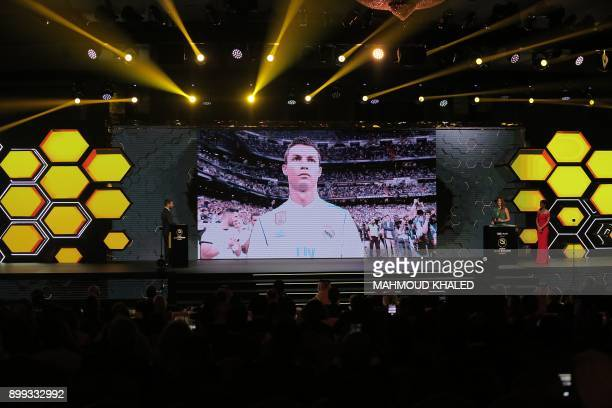 Real Madrid's Portuguese forward Cristiano Ronaldo is seen on a screen after the announcement of his reception of the Best player award during the...
