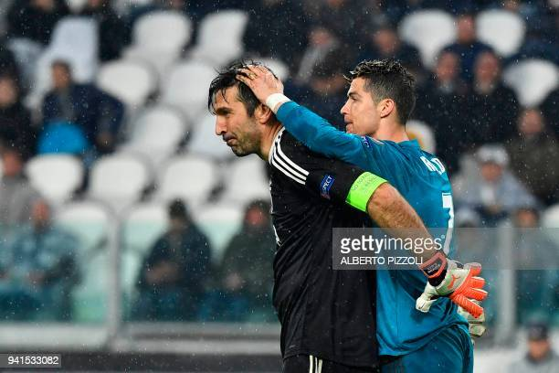 TOPSHOT Real Madrid's Portuguese forward Cristiano Ronaldo jokes with Juventus' goalkeeper from Italy Gianluigi Buffon at the end of the UEFA...