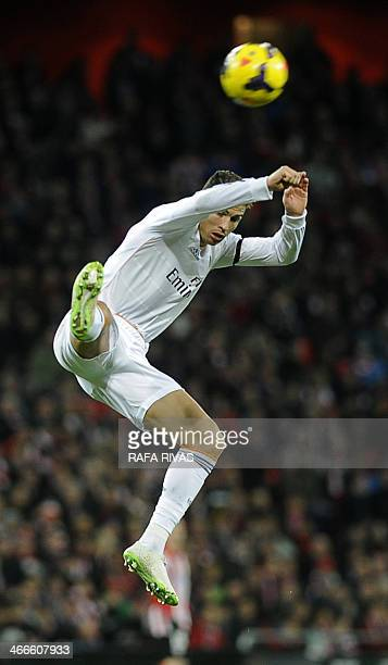 Real Madrid's Portuguese forward Cristiano Ronaldo jumps during the Spanish league football match Athletic Club Bilbao vs Real Madrid CF at the San...