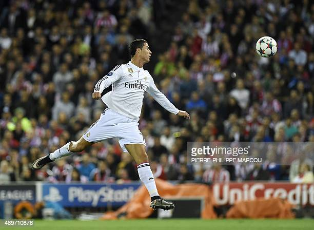 Real Madrid's Portuguese forward Cristiano Ronaldo jumps for the ball during the UEFA Champions League quarter final first leg football match...