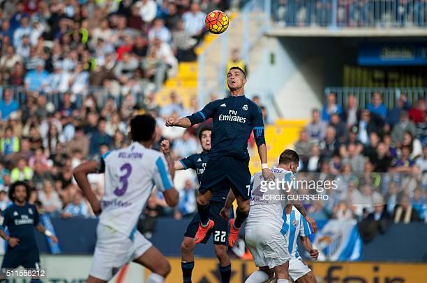 TOPSHOT Real Madrid's Portuguese forward Cristiano Ronaldo jumps for the ball during the Spanish league football match Malaga CF vs Real Madrid CF at...