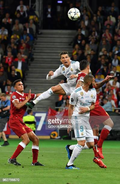Real Madrid's Portuguese forward Cristiano Ronaldo jumps for the ball during the UEFA Champions League final football match between Liverpool and...