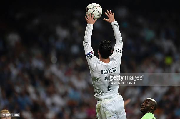 Real Madrid's Portuguese forward Cristiano Ronaldo jumps to catch the ball during the UEFA Champions League semifinal second leg football match Real...