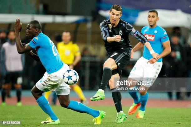 Real Madrid's Portuguese forward Cristiano Ronaldo kicks in front of Napoli's defender from France Kalidou Koulibaly during the UEFA Champions League...