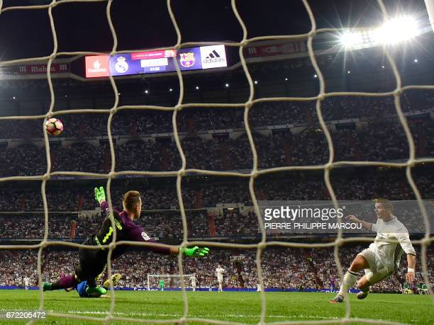 Real Madrid's Portuguese forward Cristiano Ronaldo kicks the ball during the Spanish league Clasico football match Real Madrid CF vs FC Barcelona at...