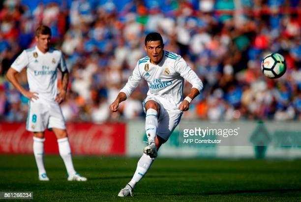 Real Madrid's Portuguese forward Cristiano Ronaldo kicks the ball during the Spanish league football match Getafe CF vs Real Madrid at the Coliseum...