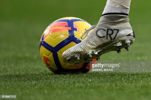 TOPSHOT Real Madrid's Portuguese forward Cristiano Ronaldo kicks the ball during the Spanish league football match Real Madrid CF against Malaga CF...