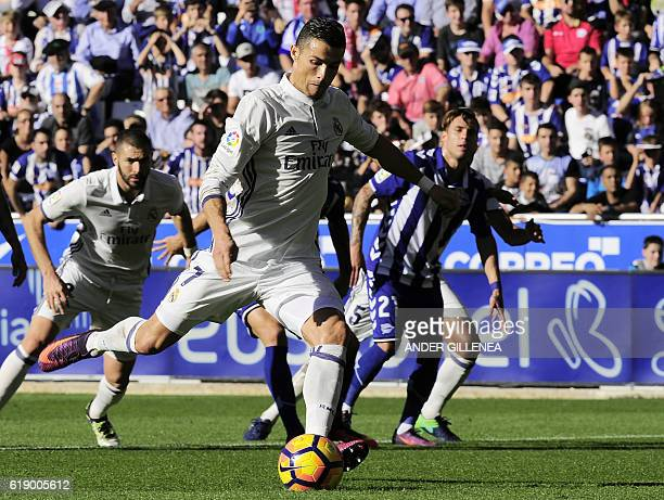 Real Madrid's Portuguese forward Cristiano Ronaldo kicks the ball to score a goal during the Spanish league football match between Deportivo Alaves...