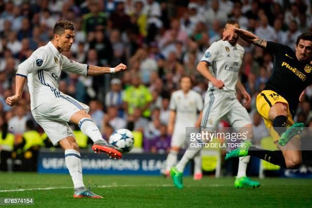 Real Madrid's Portuguese forward Cristiano Ronaldo kicks to score his second goal during the UEFA Champions League semifinal first leg football match...