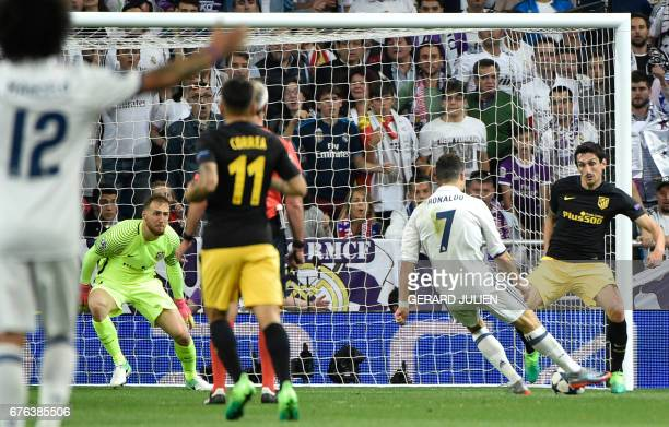 Real Madrid's Portuguese forward Cristiano Ronaldo kicks to score his third goal during the UEFA Champions League semifinal first leg football match...