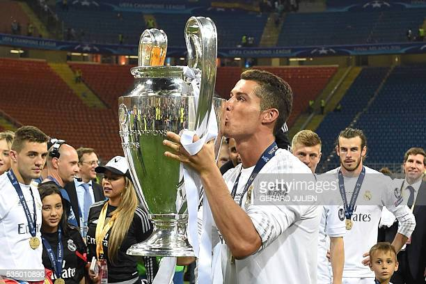Real Madrid's Portuguese forward Cristiano Ronaldo kisses the trophy after Real Madrid won the UEFA Champions League final football match over...