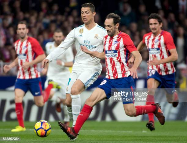 Real Madrid's Portuguese forward Cristiano Ronaldo L vies with Atletico Madrid's Spanish defender Juanfran during the Spanish league football match...