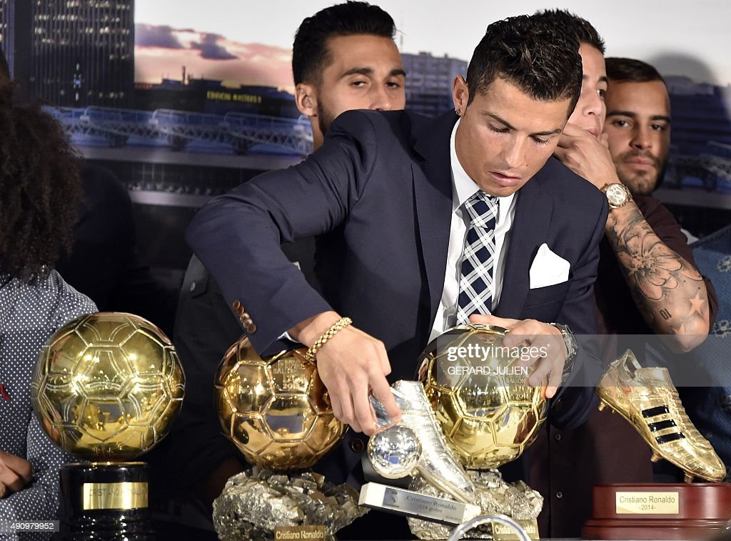 Real Madrids Portuguese Forward Cristiano Ronaldo Leaves His Leading Scorer Trophy Next To Golden