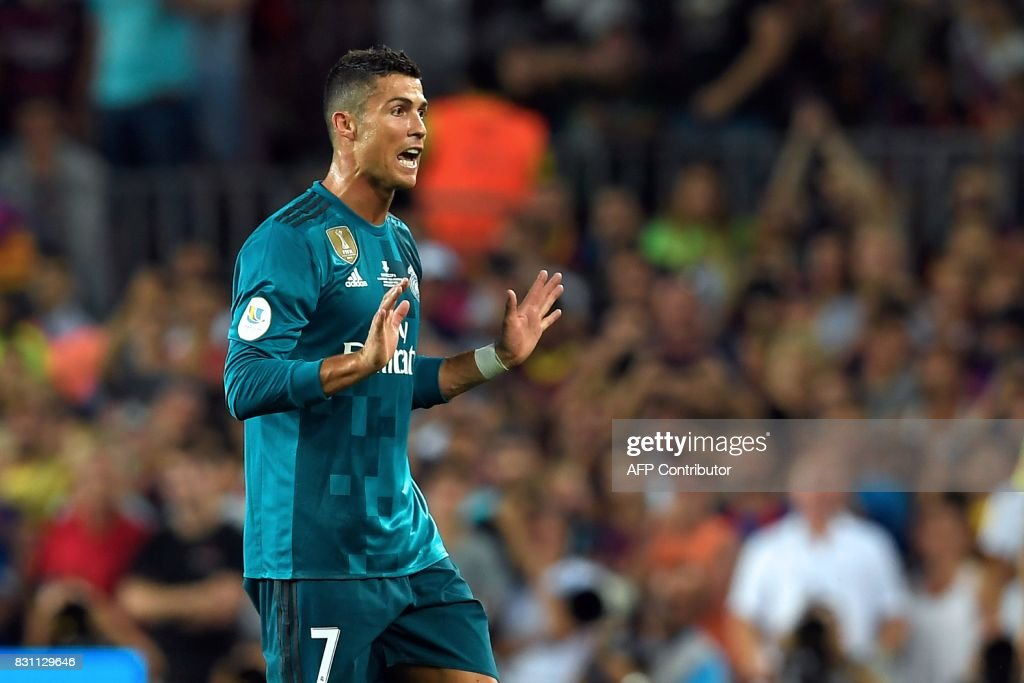 Real Madrid's Portuguese forward Cristiano Ronaldo leaves the field after receiving his second yellow card during the Spanish Supercup first leg football match FC Barcelona vs Real Madrid at the Camp Nou stadium in Barcelona on August 13, 2017. /