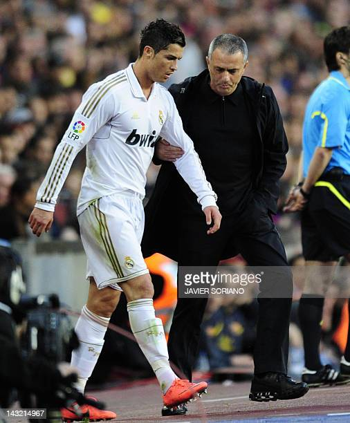 Real Madrid's Portuguese forward Cristiano Ronaldo listens to with Real Madrid's Portuguese coach Jose Mourinho during the Spanish League 'El...