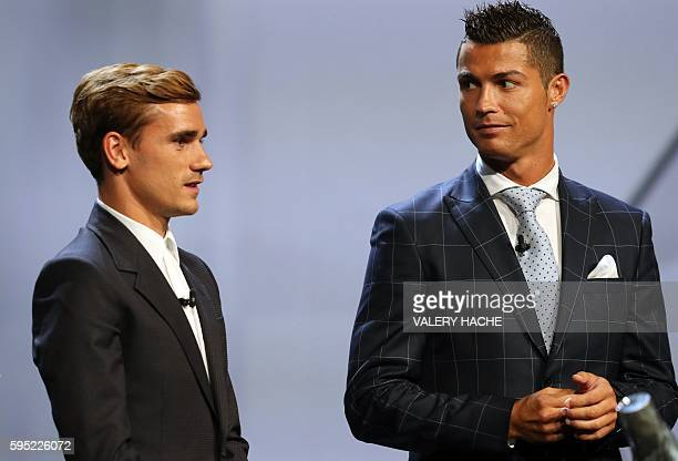 Real Madrid's Portuguese forward Cristiano Ronaldo looks at Atletico Madrid's French forward Antoine Griezmann at the end of the UEFA Champions...